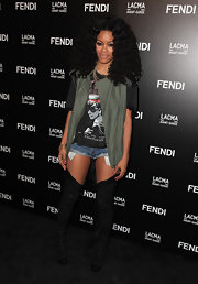 Teyana Taylor paired her cuffed shorts with black suede over-the-knee boots.