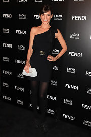 Perry Reeves showed off her one-shoulder dress while hitting the FENDI boutique opening.