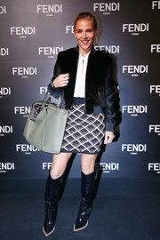 Elsa Pataky completed her tough-chic outfit with croc-embossed knee-high boots.