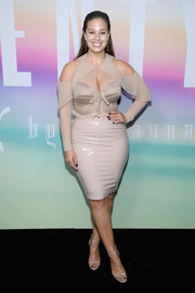 Ashley Graham finished off her monochromatic look with a pair of taupe ankle-strap heels.