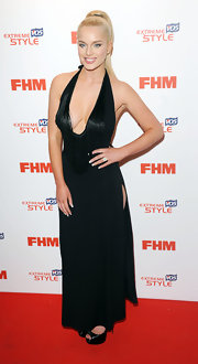 Helen Flanagan chose a super sexy red carpet look when she chose this V-neck gown with a fringe detailed neckline and a side slit.