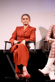 Zendaya Coleman matched her pantsuit with red T-strap peep-toes by Casadei for the premiere of 'Euphoria.'