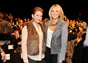 Lo wore a fur vest over a white button up for an eclectic fashionable look at the Rebecca Minkoff Fall show.