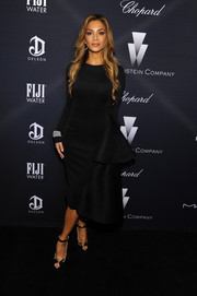 Nicole Scherzinger added subtle shine to her dark outfit with a pair of silver platform peep-toes.
