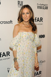 Layers of chain bangles added an edgy touch to Sarah Jessica Parker's amfAR Inspiration Gala gown.
