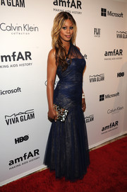 Laverne Cox looked diva-ish in a blue sheer-panel one-shoulder gown during the amfAR Inspiration Gala.