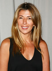 Nina Garcia sported a long sleek center-parted 'do at the Artistry of Fashion Award luncheon.