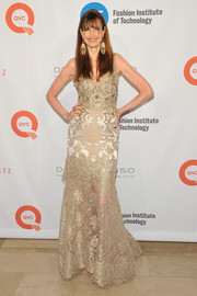 Carol Alt glammed it up in a gold lace gown with a beaded bodice at the FIT Gala honoring Dennis Basso.