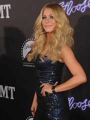 Julianne Hough attended the 'Footloose' screening in Nashville with her long, luxurious locks in voluminous waves. To recreate her look, curl two-inch sections of hair with a large-barreled curling iron, backcomb and mist with a product like Bumble and Bumble Does It All Spray for added texture and hold.