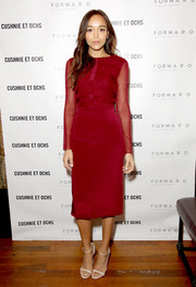 Ashley Madekwe completed her sophisticated look with a red Cushnie et Ochs pencil skirt.