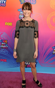 Katie Aselton paired her chunky sandals with a lace embellished day dress.