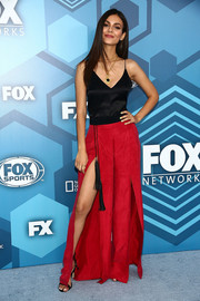 Victoria Justice teamed her cami with a cool pair of slit red wide-leg pants by The Jetset Diaries.