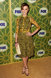 Jayma Mays freshened her bold print dress with an ivory clutch.