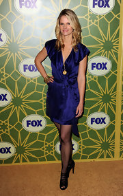 At the FOX soiree, Joelle Carter opted for a blue satin dress paired with black strappy sandals.
