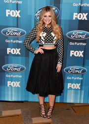 Lauren Alaina teamed her top with a pleated black skirt.