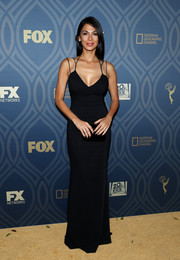 Moran Atias looked sexy and sophisticated in a form-fitting black gown with a strappy neckline during Fox Broadcasting's Emmy Awards after-party.