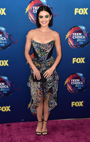 Black slim-strap sandals by Jimmy Choo sealed off Lucy Hale's look.