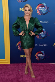Olivia Holt shimmered in a plunging emerald cocktail dress by Daniele Carlotta at the 2018 Teen Choice Awards.