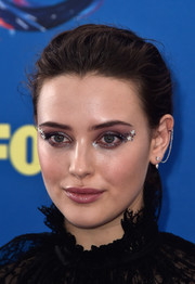 Katherine Langford styled her hair into a messy-chic chignon for the 2018 Teen Choice Awards.