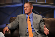 John Cena adds spunk to a gray suit with a bright yellow dotted tie.