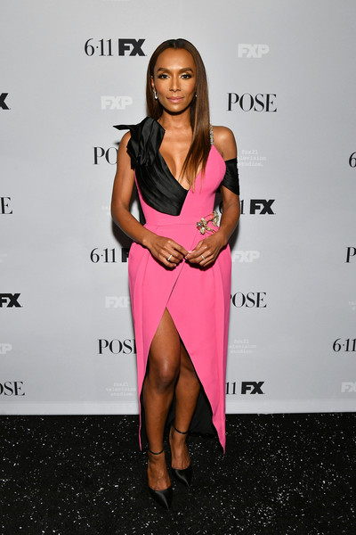 Janet Mock flaunted her cleavage and legs in a pink and black Prada dress with a plunging neckline and a high slit at the premiere of 'Pose' season 2.