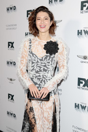 Mary Elizabeth Winstead paired a beaded black clutch with a sheer lace dress for the FX Networks Emmy nominees celebration.