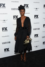 Adina Porter brightened up her look with a metallic envelope clutch.