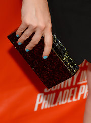 Judy Greer accessorized with an elegant mother of pearl-inlaid box clutch at the FXX Network launch.