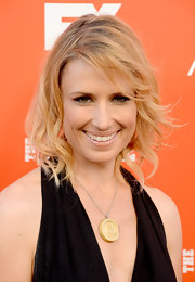 Shawnee Smith accessorized with a chunky gold pendant necklace during the FXX Network launch.