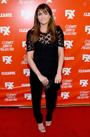 Amanda Peet went for a conservative look with a pair of black slacks and a lace top during the FXX Network launch.