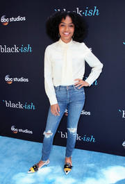 Yara Shahidi contrasted her demure top with edgy ripped jeans.