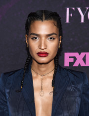 Indya Moore accentuated her pout with a swipe of ruby-red lipstick.