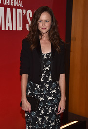 Alexis Bledel teamed a black box clutch with a print dress and a cropped jacket for the 'Handmaid's Tale' FYC event.