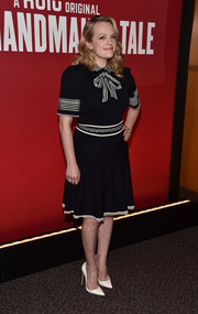 Elisabeth Moss finished off her top with a matching flared knee-length skirt.