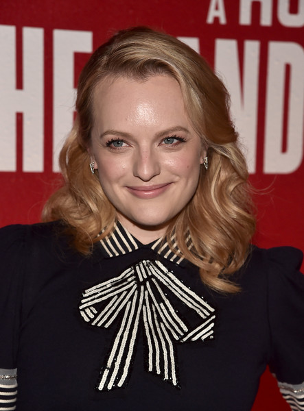 Elisabeth Moss went vintage with this shoulder-length curly 'do that showed off her earrings by Eva Fehren at the FYC event for 'The Handmaid's Tale.'