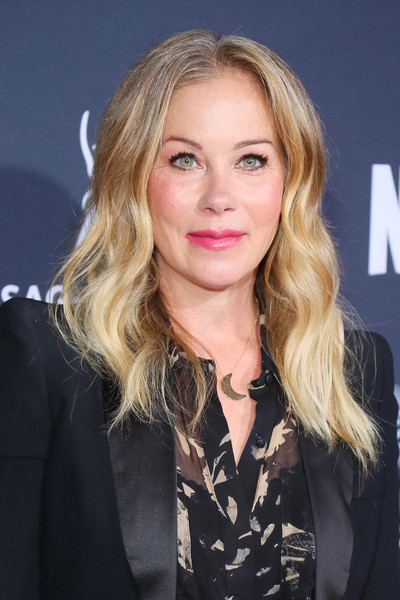 Christina Applegate wore her hair down in a center-parted, wavy style at the Rebels and Rule Breakers event.
