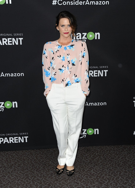 Amy Landecker completed her outfit with basic white slacks.