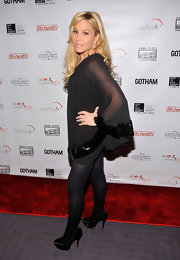 Platform pumps seem to be Adrienne Maloof's favorite fashion item. This time, she wore black satin ones.