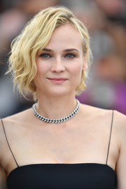 Diane Kruger went for tough-chic styling with a silver chain necklace.