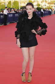 Roxanne sizzled in a pair of leopard print ankle boots while hitting the premiere of 'Fair Game'.