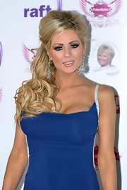 Nicola McLean attended a charity event in Scotland wearing her blond strands in a voluminous style with long tousled curls.