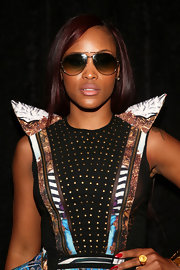 Eve's aviator sunglasses showed the singer's rocker edge especially when paired with a funky abstract dress.