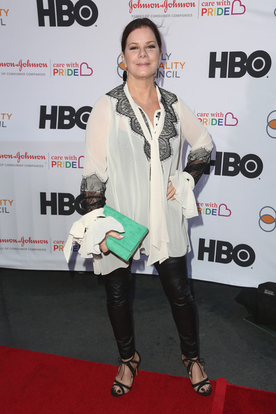 Marcia Gay Harden donned a loose white tie-neck blouse with black lace trim for the 2018 Impact Awards.