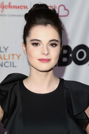 Vanessa Marano swept her hair back into a loose bun for the 2018 Impact Awards.