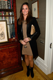 Pippa Middleton stayed stylishly cozy in a black wool coat with leather details during the launch of her new book.