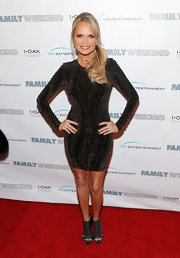 Kristin Chenoweth chose a long-sleeved cocktail dress for her red carpet appearance at 'Family Weekend'