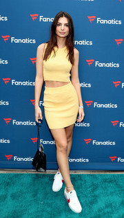 Emily Ratajkowski kept it breezy in a yellow knit crop-top by Bec + Bridge at the Fanatics Super Bowl Party.