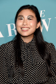 For her beauty look, Awkwafina got playful with a heavy application of glitter eyeshadow.