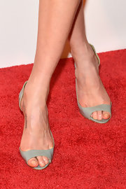 Lily Cole opted for simple gray open-toe shoes when she attended the Fashion 4 Development First Ladies Luncheon.