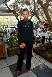 Karlie Kloss chose a pair of black David Koma pants with embellished sides to complete her outfit.